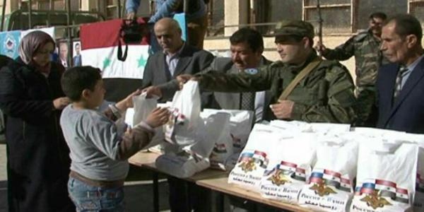Humanitarian Aid from Russia distributed among Izra' citizens in Daraa province