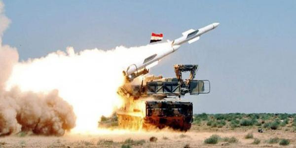 Syrian Air defense intercepts a missile aggression on one of military airbases in central region