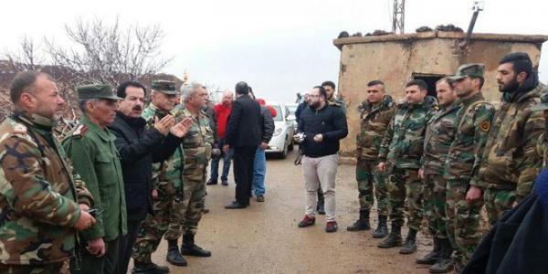 Honoring one the army's formations at al-Touloul al-Homr in Quneitra