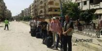 Secondary school students from Yarmouk Camp return after taking final exam