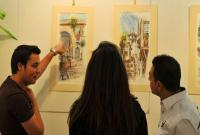Artist Mohammad Hisham Al Khayat holds an art gallery at the cultural department in Abu Roumana.