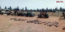 Terrorists continue handing over weapons in Homs and Hama countryside